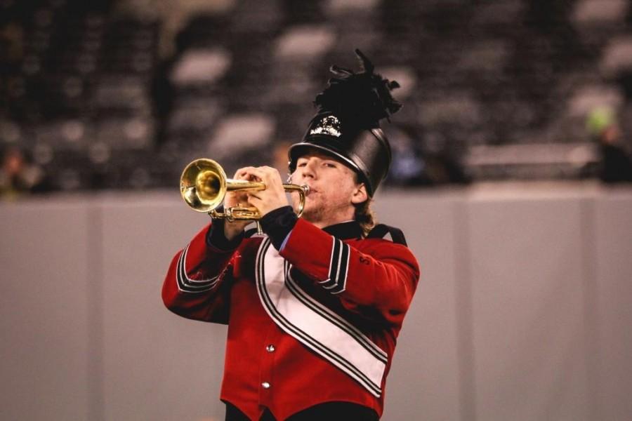 Senior trumpet player Dan McAuley shows off his skills at MetLife stadium.
