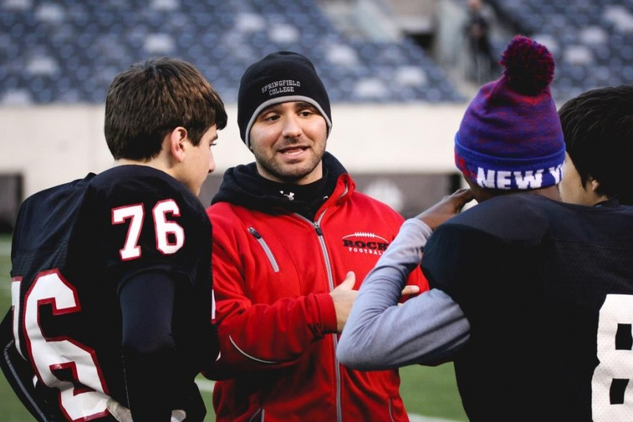Coach Escalante gives a pep talk to freshman players Jared Lipsky and Naz Brady.