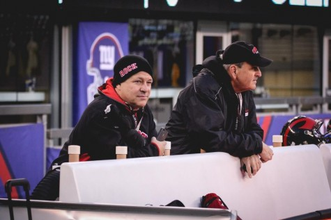 Principle John Arlotta and Athletic Director Frank Violante watch the final game from the sidelines.