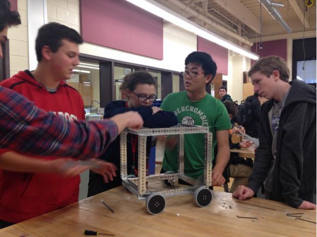 The GRHS Robotics team working on a robot.