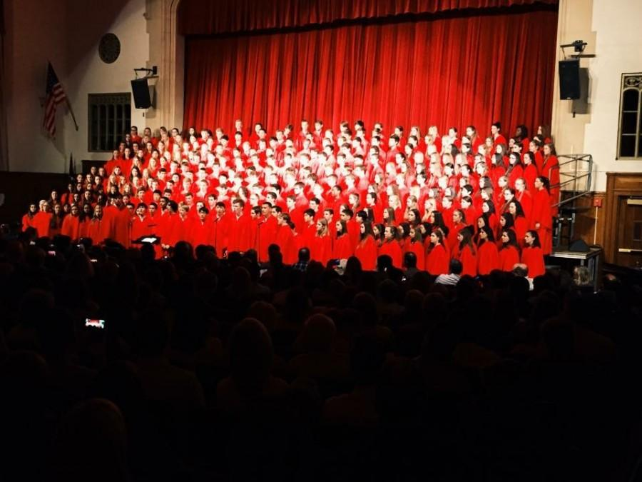 Performing at the 2014 Winter Concert the choir sings in front of a large audience.