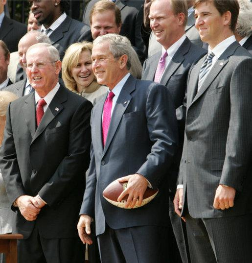 Former Giants' Coach Tom Coughlin with president George Bush and Giants' quarterback Eli Manning
