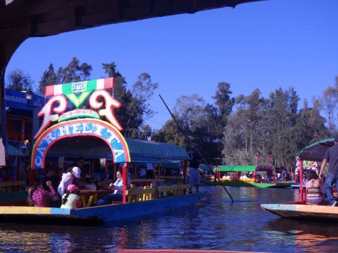 Boats float on the Xochimilco Canal. The Canal is a designated UNESCO World Heritage Site and is a local favorite.
