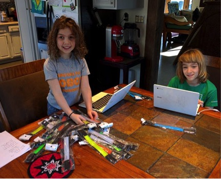 Kurt (10) and Maya (8), Shapiro's two children, helped him sort through the armbands and personally deliver them to each household.