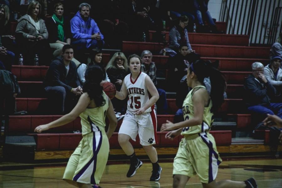Julia Gaffey looks for an open pass down the court.