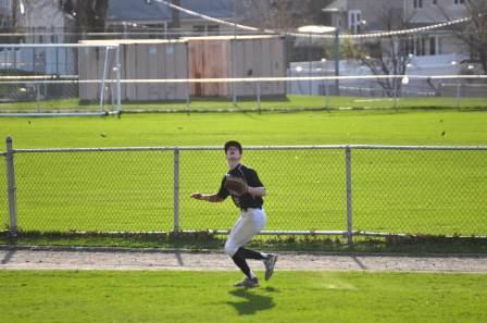 Max Felsenstein ('16) tracking down a long fly ball in a 15-5 win over Elmwood Park