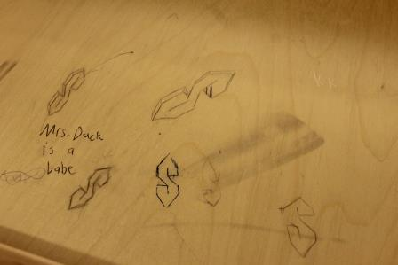Writings and drawings can be seen on the inside of the desks