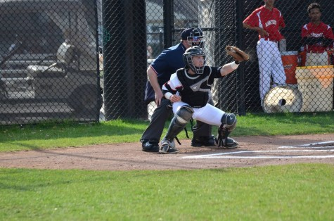 Scandale, catching a pitch during last week's season opening win against Manchester, 20-0.