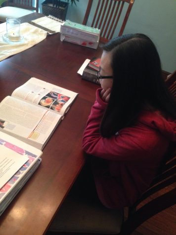 Roddy sits at her dining room table, working on her Biology homework, the class she dedicates the most time to.