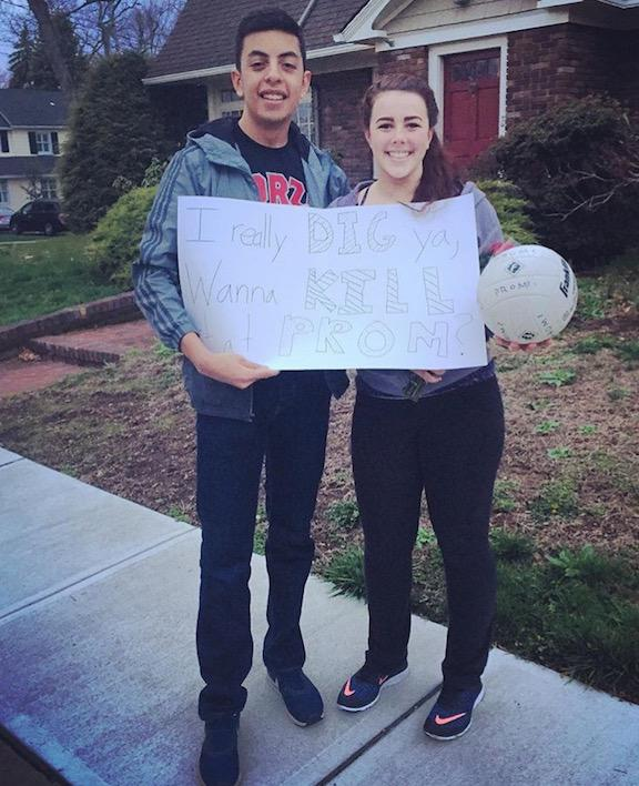 Sergio Galvez asked varsity volleyball player Lizzie Alba with a volleyball inspired poster.