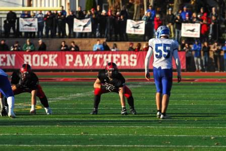 Jeremy Lipsky lining up on offense before a play against Hawthorne in the state semi finals.