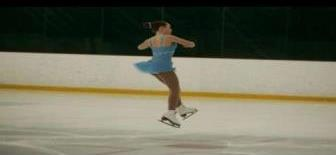 Anna jumping and performing a double spin, which is an advanced skating technique.