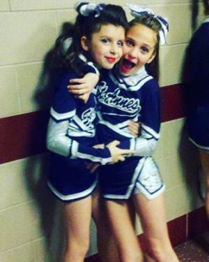 Brenna Drummond is on the left next to Sophia Arnao. This was taken of the two best friends before performing at a competition in 2009 on the St. Anne's cheerleading team.