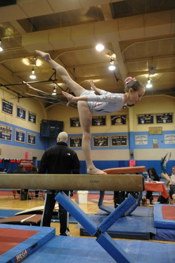 Sophia Arnao on beam at a state competition in May 2010