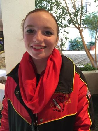 Anna at her first synchronized competition in 2014 in Amherst,Massachusetts. She is wearing her red Synchroettes jacket with a matching red scarf.
