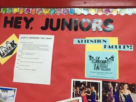 The bulletin board in the junior hallway showcasing a 2016 Teacher Talent Show advertisement.