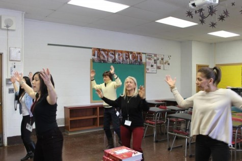 Lesley Breuer, Rochelle Forstot, Kirsys Guevarez, and Marisa Davitt practice a zumba number, choreographed by Breuer, to perform in the 2014 Teacher Talent Show.