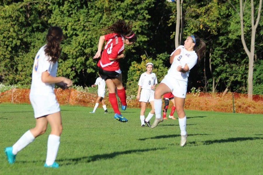 Julia midair after a header during a game against Eastern Christian.
