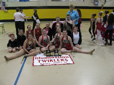 Illumination Twirlers pose for a picture after winning trophies for a competition.