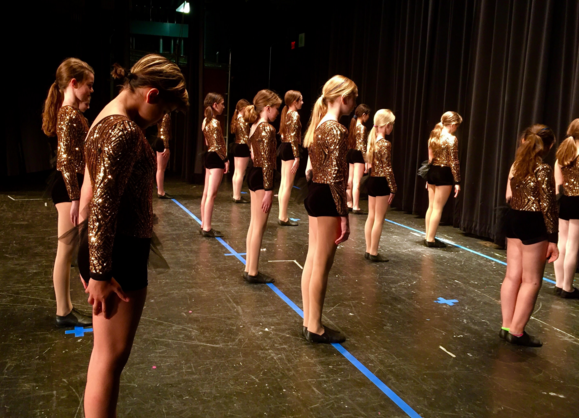 Fifth grade Byrd dancers prepare onstage for