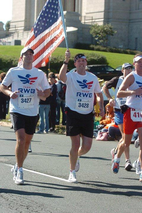Jonathan Algor, advisory board member for Team Red, White & Blue, and founder, Mike Erwin, run in the Minnesota Twin Cities Marathon in 2009. This was the first event Team Red, White & Blue organized (Photo Credit: Jonathan Algor)