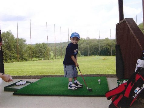 Schwendemann strikes a pose before teeing up a golf ball at the driving range.