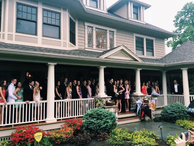 Junior students pose for a picture at the Cassidy household before attending their prom.