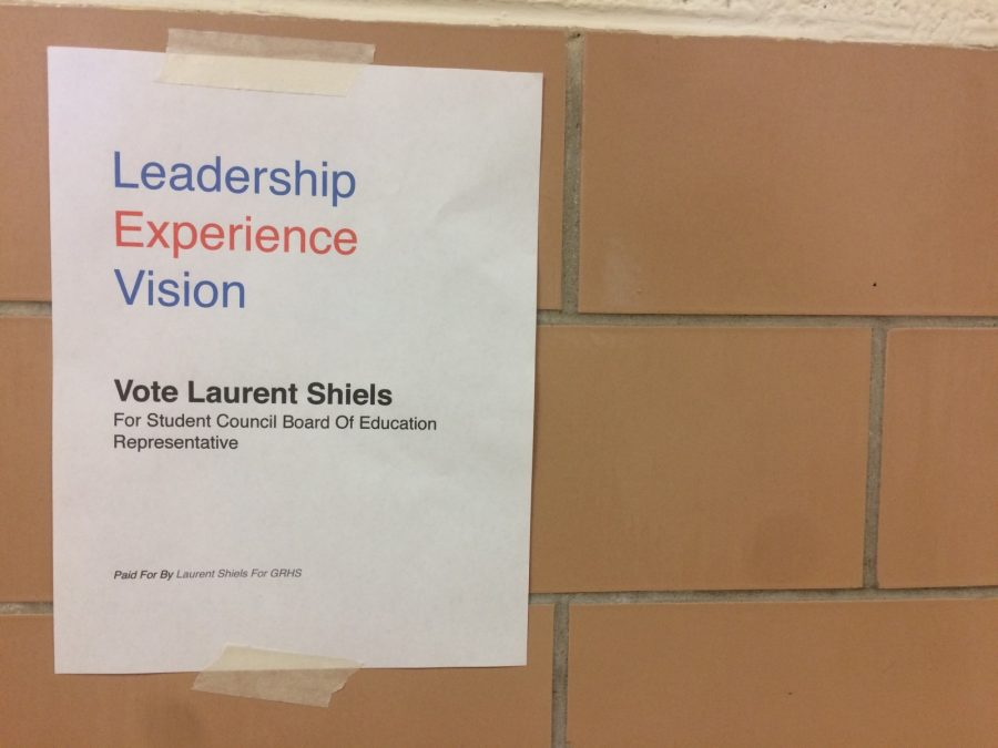 Laurent+Shiels+advertises+his+political+campaign+in+the+halls.