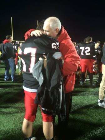Father, Michael O'Hagan and son, Mike O'Hagan share a hug years in the making after the Hawthorne semi-final game.