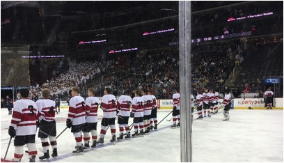 Glen Rock varsity hockey team lined up across the ice for the pledge of allegiance before hearing this would be Coach Sergio Fernandez's last game with the team.