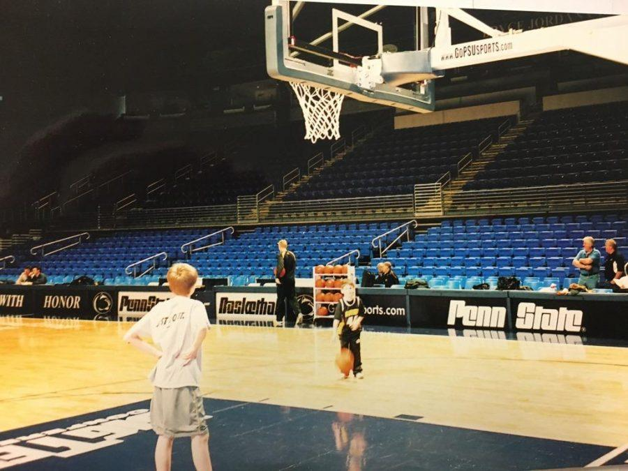 Weiss shooting baskets on the Pennsylvania State University basketball court with Bryce Alford, a current UCLA point guard and future NBA prospect.