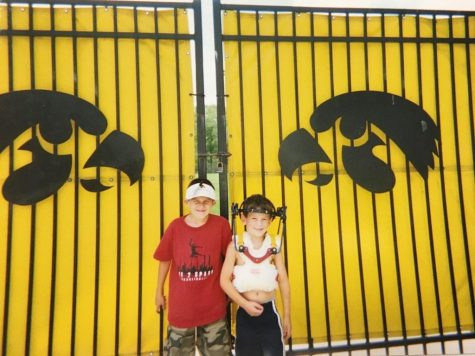 Weiss is posing in front of the football team's practice facility with Xavier, a friend he made at the Ronald McDonald House.