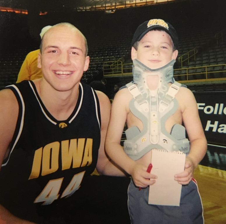 On Basketball Media Day, Weiss met Greg Brunner, one of the best Hawkeyes to ever play. Weiss is sporting his Aspen brace, which he got after his halo brace was no longer necessary.