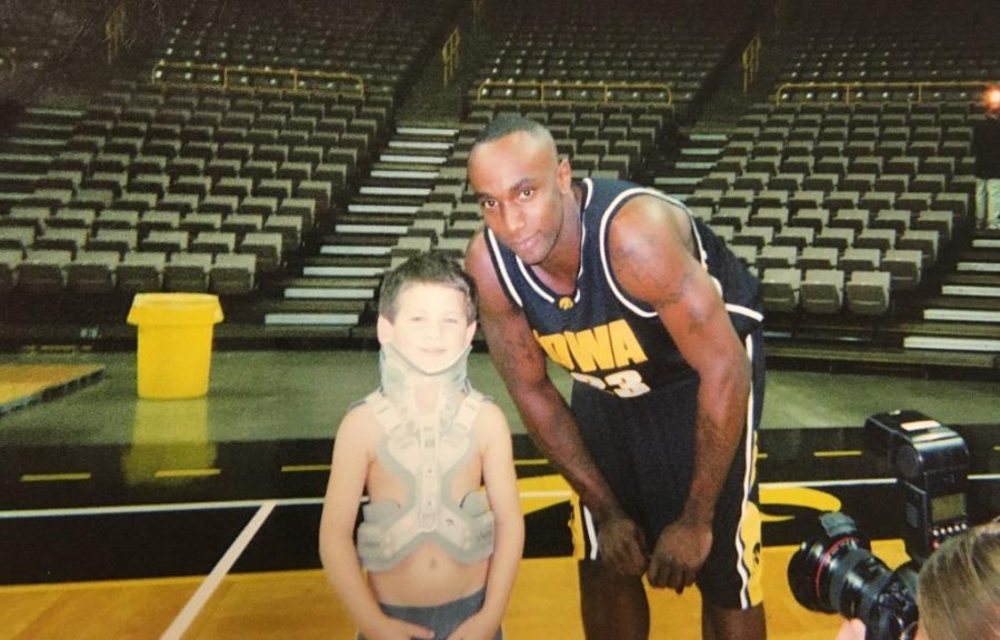 Weiss loved spending time on the court and taking photos with all the players. Here he is posing with Doug Thomas.