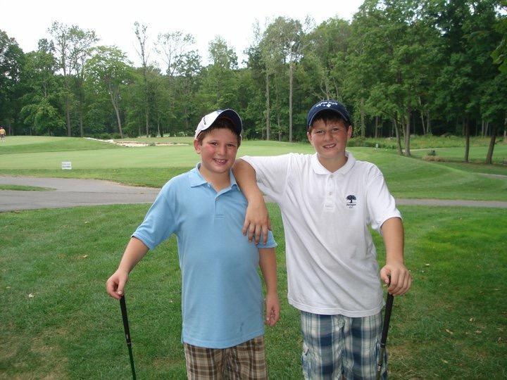 John Lamacchia poses on a South Carolina golf course in 2008 with brother Thomas lamacchia (20').
