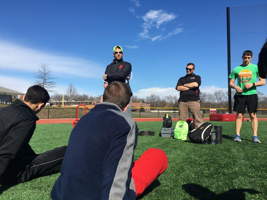 Coach McCarten, Luckenbill and Cukozo like to break down the practice each day for the players.