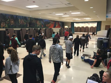 On days where it is difficult to practice outside due to poor weather conditions, the coaches take practice indoors, where the athletes warm up in the cafeteria.