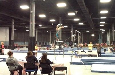 Sydney Struble practicing on the low bar.