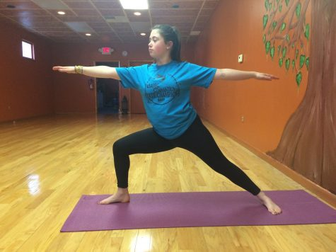 Struble doing the Warrior II pose at Naturally Yoga.