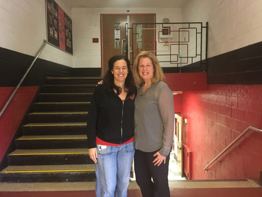 Lisa Mulcahy (right) and a volunteer (left) pose in front of the stairs that lead up to the entrance of Grad Ball which is blocked of to the public.