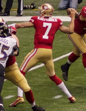 San Francisco 49ers starting quarterback is protesting American racism by kneeling during the National Anthem.