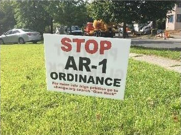 A lawn sign on Prospect Street advising people to sign a petition in protest of AR-1 Ordinance