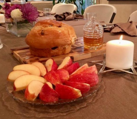A traditional table setting for a Rosh Hashanah dinner.