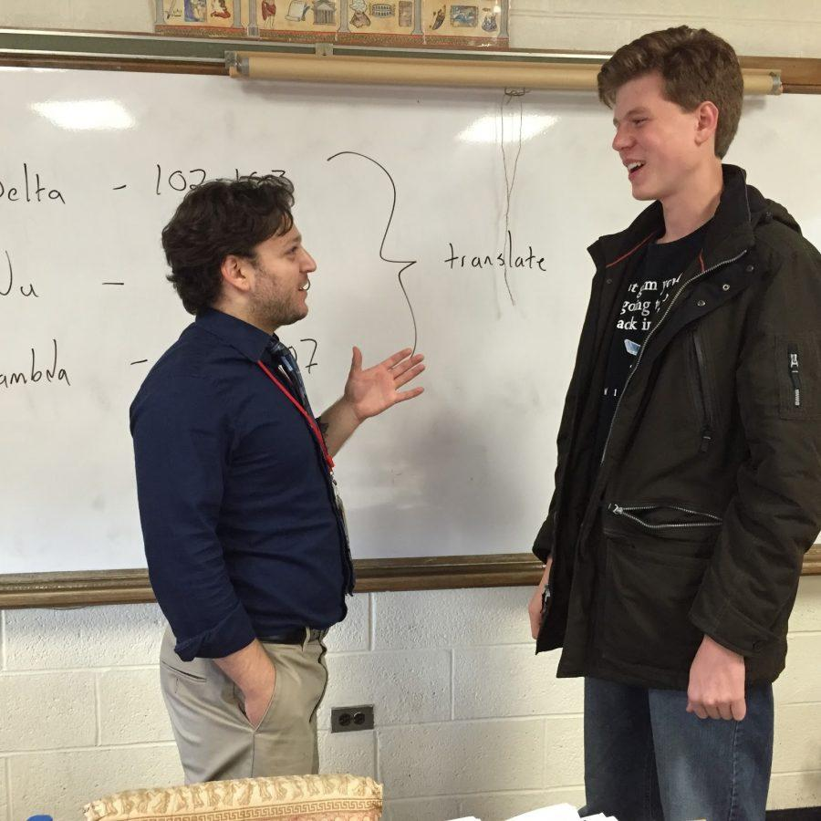 Montalbano (left) and Beezley (right) discussing the next Latin Club meeting. These two often talk after school about ideas and themes for future events.