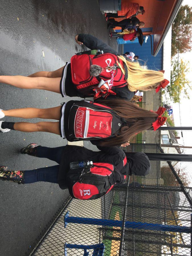 Following the breakfast, both seniors and captains, Sophia Arnao ('17) and Caitlyn Drace ('17) walk alongside Coach Alyssa Perry on the rainy Saturday afternoon in Lodi, New Jersey.