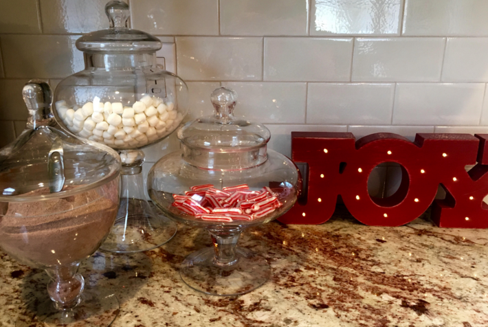 Hot+chocolate+bar+using+Swiss+Miss+hot+cocoa+mix%2C+marshmallows+and+candy+canes+displayed+in+three+glass+jars.