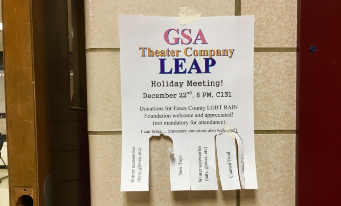 Poster, advertising the holiday meeting, put up throughout the school for students to take the name of the item they plan to donate.