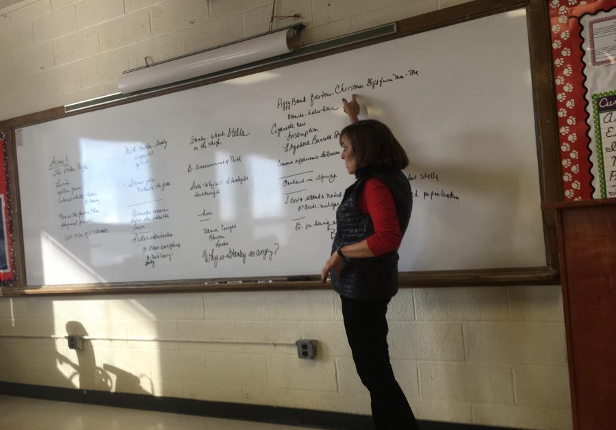 Mrs. Diane McNicholas teaches her English 11 Honors class about