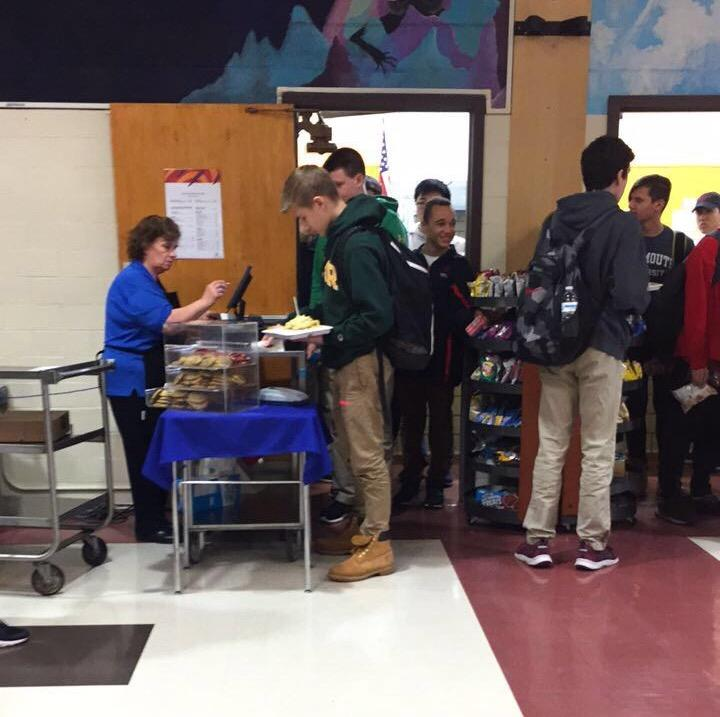 Students+stand+in+line+waiting+to+purchase+their+lunches+and+snacks.+