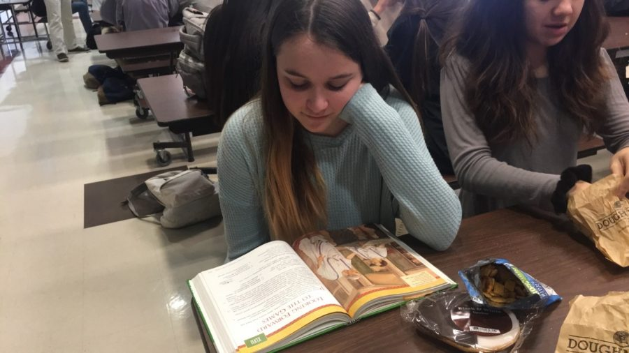 Freshman+Megan+Mulholland+reviews+her+Latin+textbook+before+an+upcoming+test.